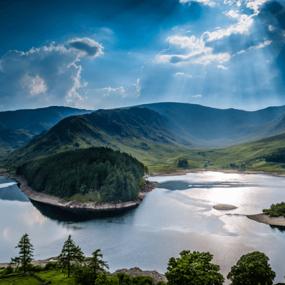 A beautiful lake surrounded by wooded hills