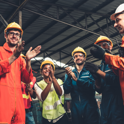 Workers in a warehouse applauding