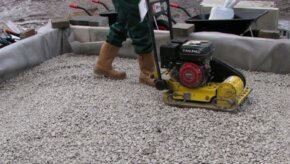 Sub base layer aggregate being compacted
